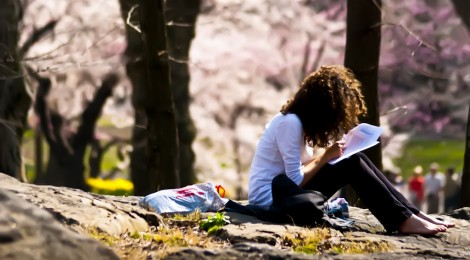 Image courtesy of Flickr.  A woman studying in Central Park, NYC. Photographer: www.WeisserPhotography.com