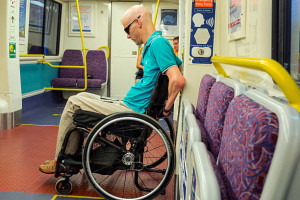A disabled man in wheelchair in a Trans Link train, Brisbane