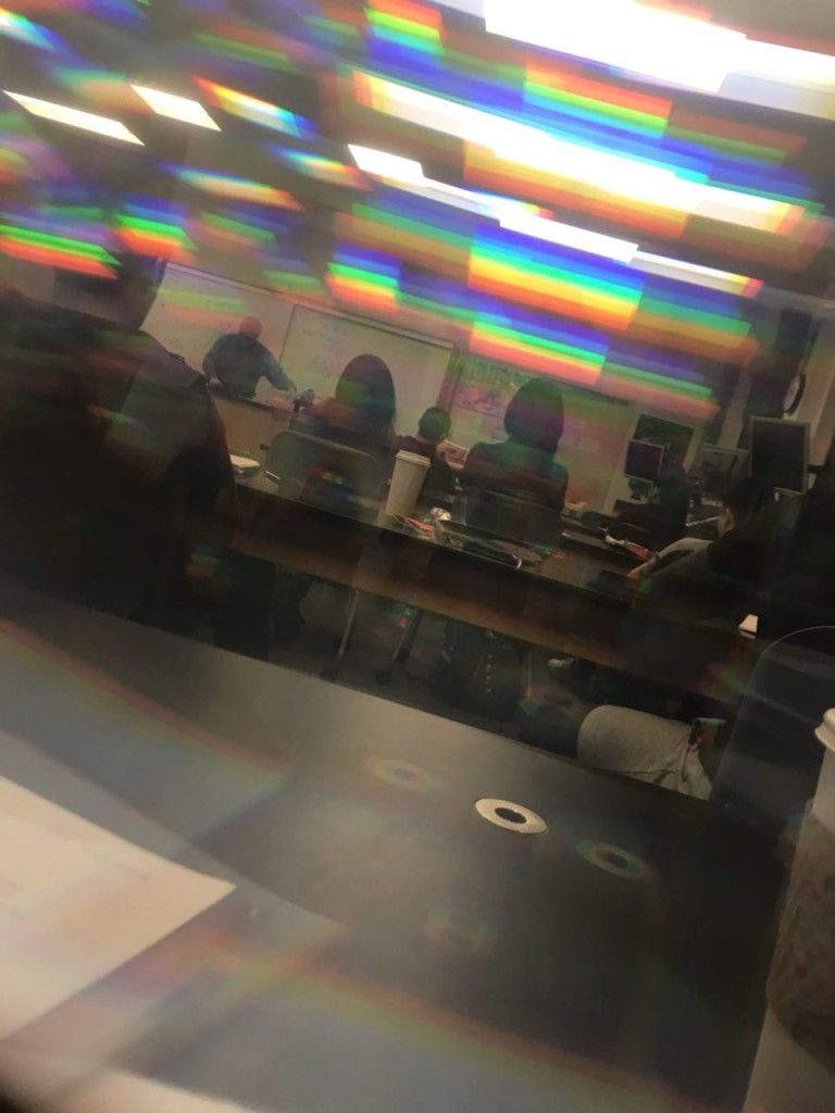 Looking through a pair of diffraction glasses as we learned about light and wave properties in an upper division physics class in Green River College.