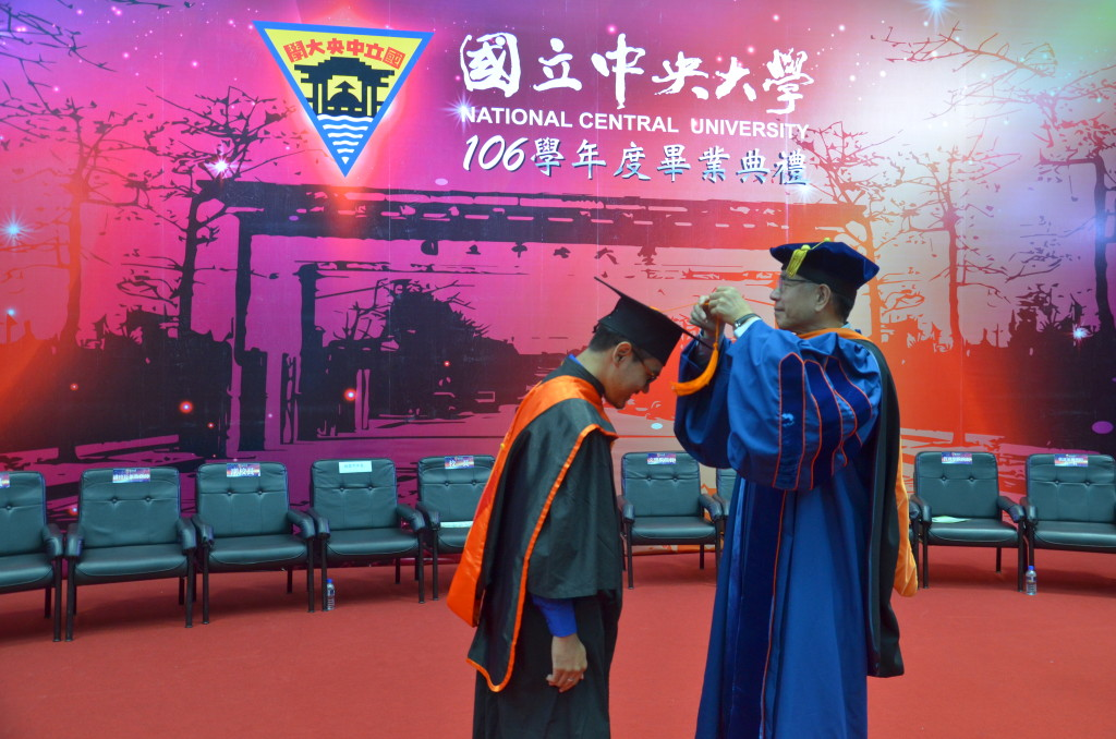 Graduation ceremony with Professor Jou-Jing Yang