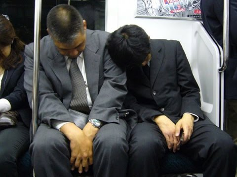 A common sight on Japan's trains– tired 'salarymen' or workers sleep on the trains after a long day at work