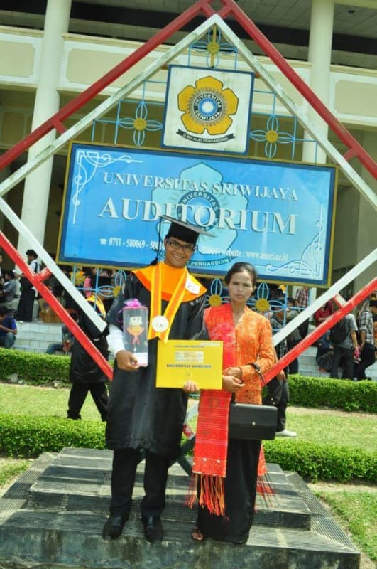 Robinson graduating from Universitas Sriwijaya in Palembang