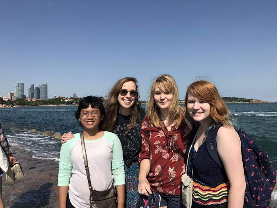 Inef with her classmates in Qingdao, Shandong province, China. They visited a beach that has a historical pier dating back to the Germany invasion of Qingdao. This group travel was a part of the mandatory UNCA requirements for all International Studies majors.