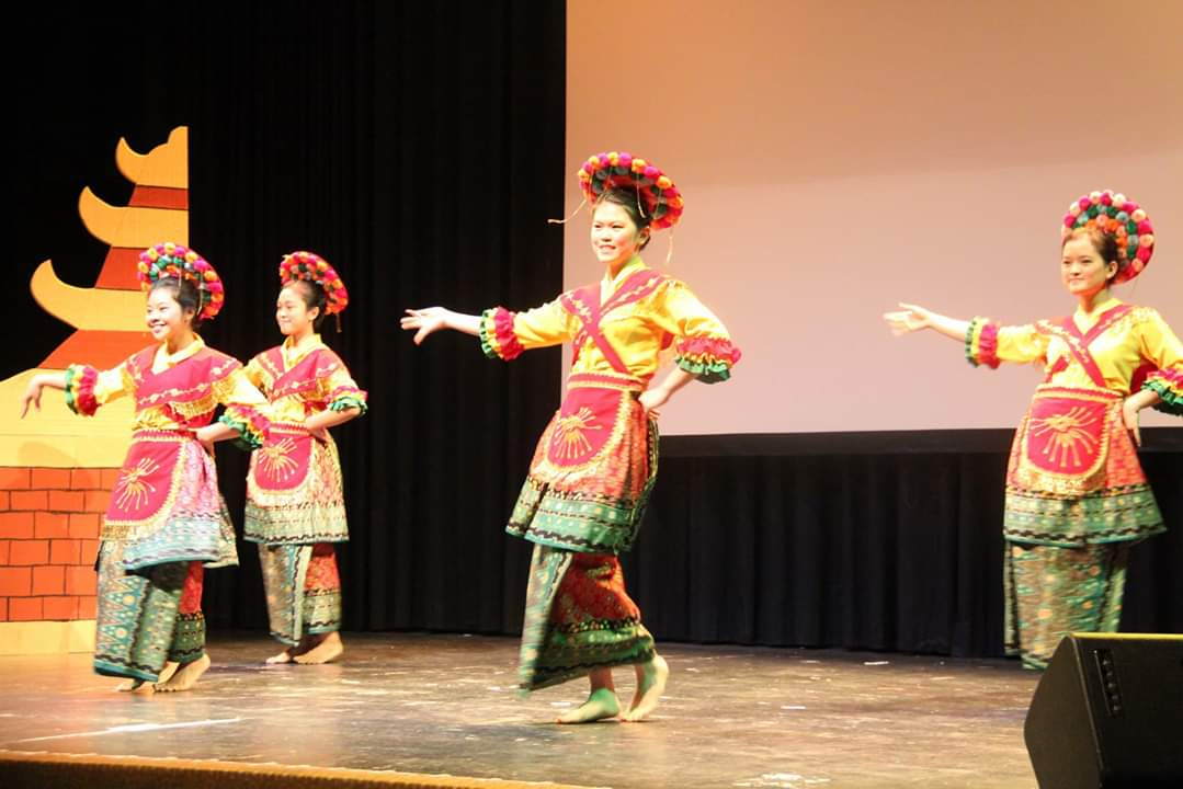 Ismi, back left, performing Tari Betawi, an Indonesian traditional dance with her friends at a cultural night event