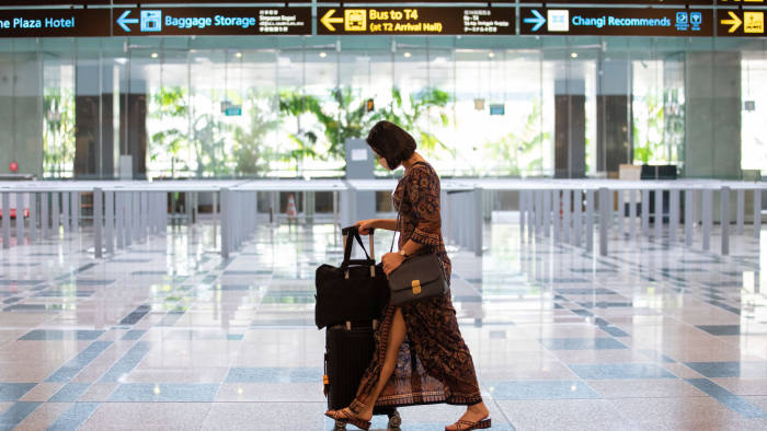 A SIA stewardess passing by - courtesy ofHow Hwee Young from Shutterstock