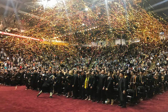 A special moment for Audrey: the end of the commencement ceremony for the College of Science and Engineering in 2019.