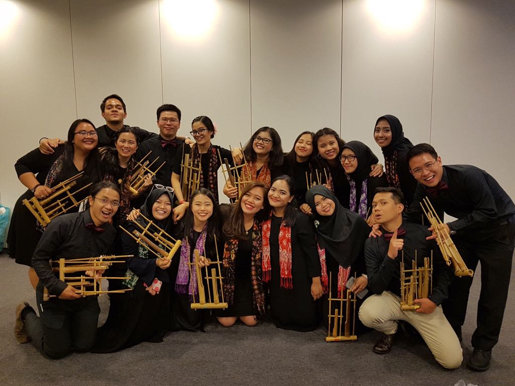 Puji, front, second from the right, and her friends before playing angklung