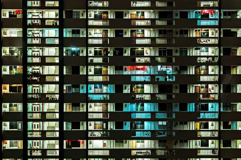 White concrete building with lights - courtesy ofpikrepo.com