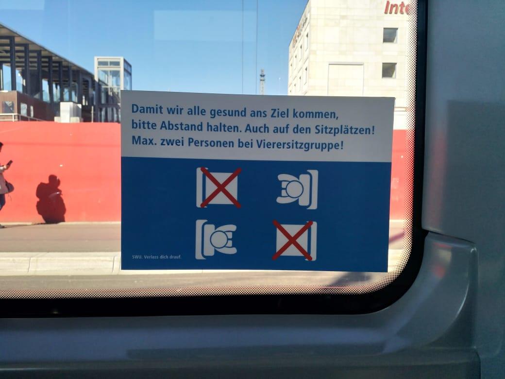 Imbauan physical distancing di kendaraan umum dalam Bahasa Jerman