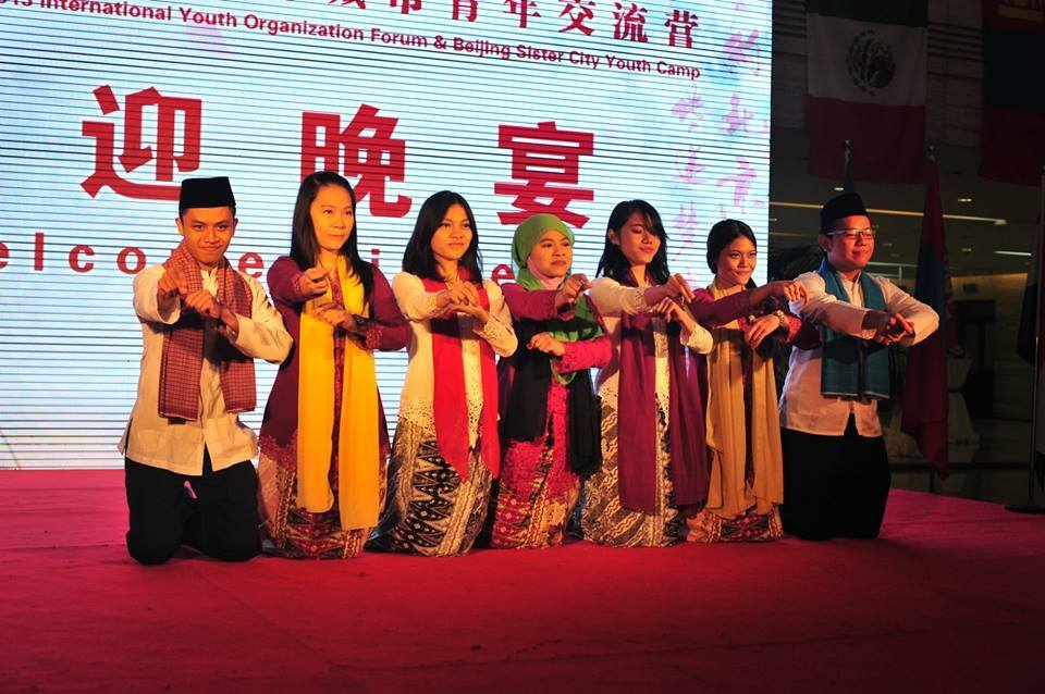 Arnald, left, and his contingent from Jakarta performing Tari Nandak Betawi at the International Youth Organization Forum and Beijing Sister City Youth Camp in Beijing, China