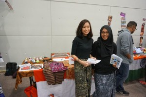 Members of the Indonesian students society (IndoSoc) manning their booth, promoting Indonesian culture to fellow students at the Global Village event, University of Southampton, UK