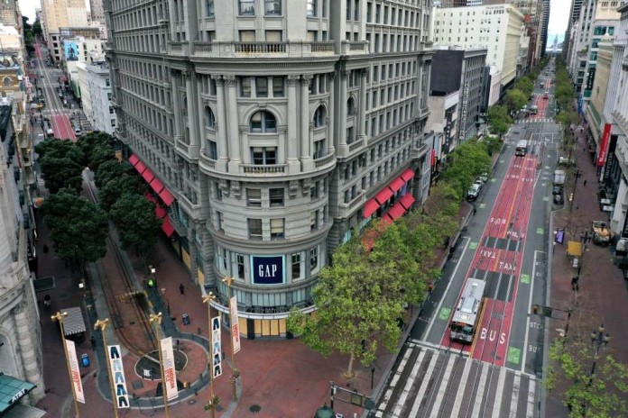 Market St, arguably the busiest street in San Francisco, shown deserted during the beginning of Bay Area lockdown in March (source: SFGate)
