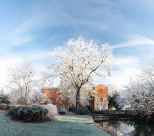 A picturesque scenery of the University of Buckingham's campus with the Old Tanlaw Mill Building in the background, used for dining and social. Source: University of Buckingham Pinterest.