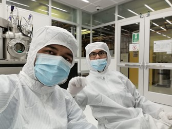 My friend and I spending time to deposit metal in nano-fabrication lab. Photo provided by Author.
