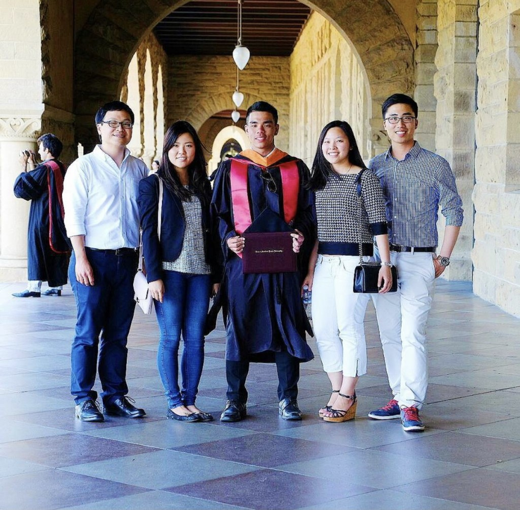 Robin (in the middle) and friends at graduation ceremony at Stanford University back in 2017.