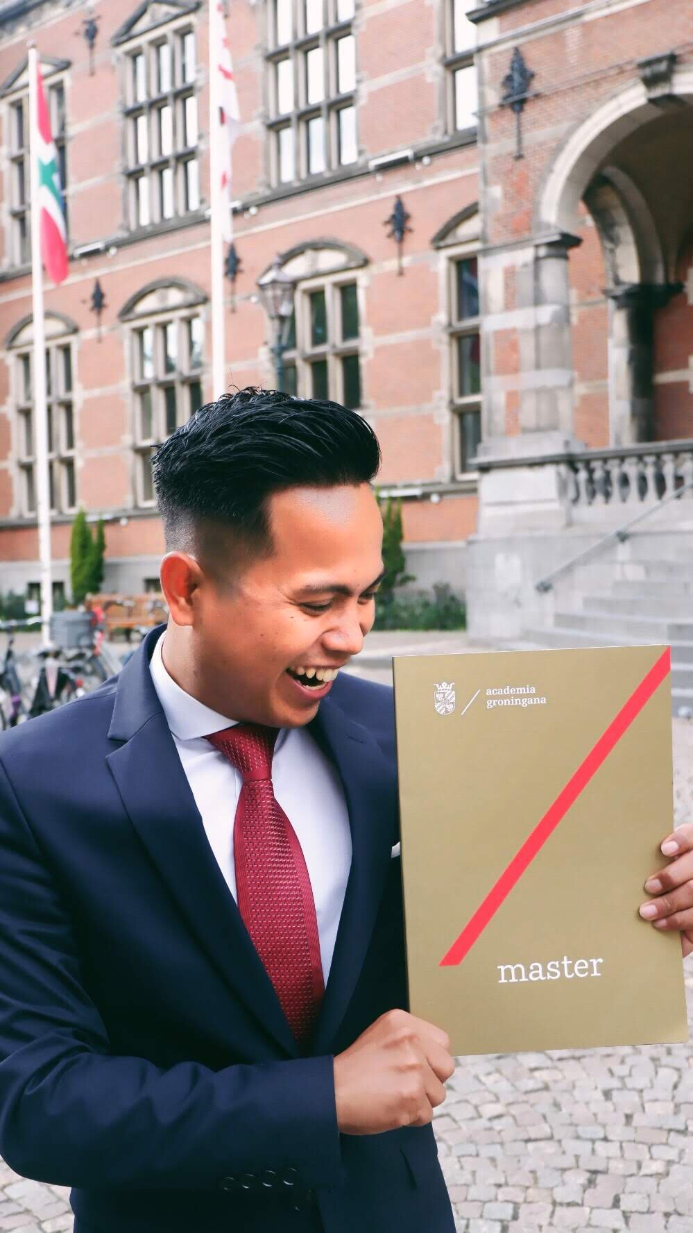 Scott's happy face on his graduation day at the University of Groningen