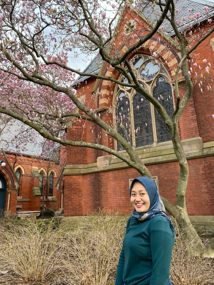 Raisa posed in front of a blossoming cherry tree in Cornell University.