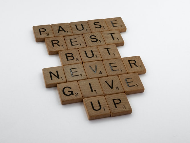A wooden block puzzle with the motivating words