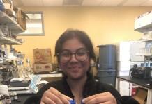 Karissa held samples of liquid infant formula.