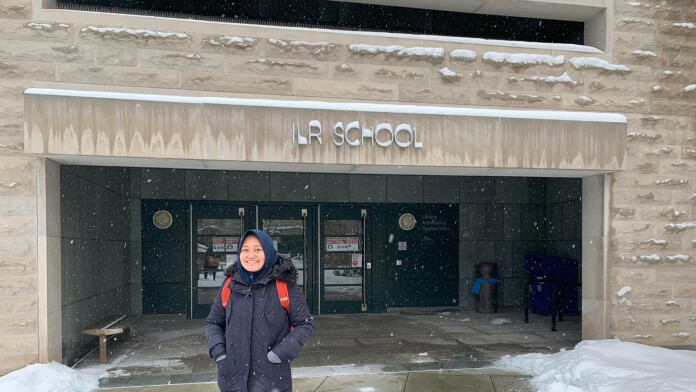 Raisa stood at the front entrance to Cornell University's School of Industrial and Labor Relations.
