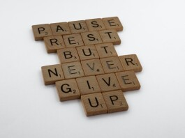 """A wooden block puzzle with the motivating words """"pause, rest, but never give up"""""""