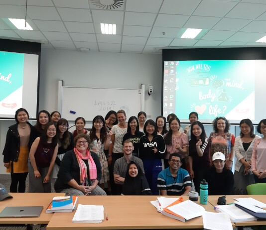 Yuri, her classmates, and lecturer in a classroom at Victoria University of Wellington. Source: Personal documentation