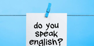 Do You Speak English Written On White Paper Hanging On Blue Background With the Latch